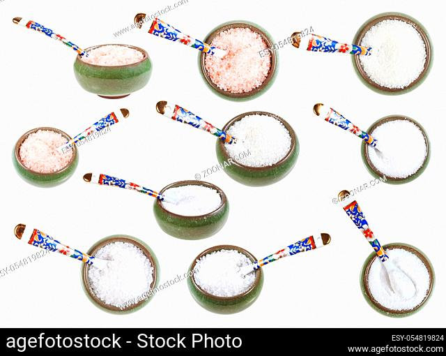 set from ceramic salt cellar with spoon with various salts isolated on white background