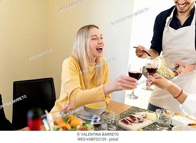 Friends having lunch together, drinking red wine