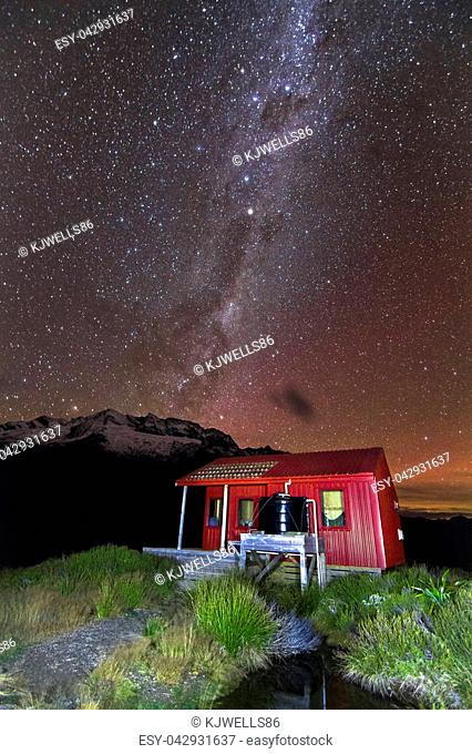 Stars and the Milky Way Galaxy are visible above Liverpool Hut in the Matukituki Valley, Mt. Aspiring National Park, south island of New Zealand