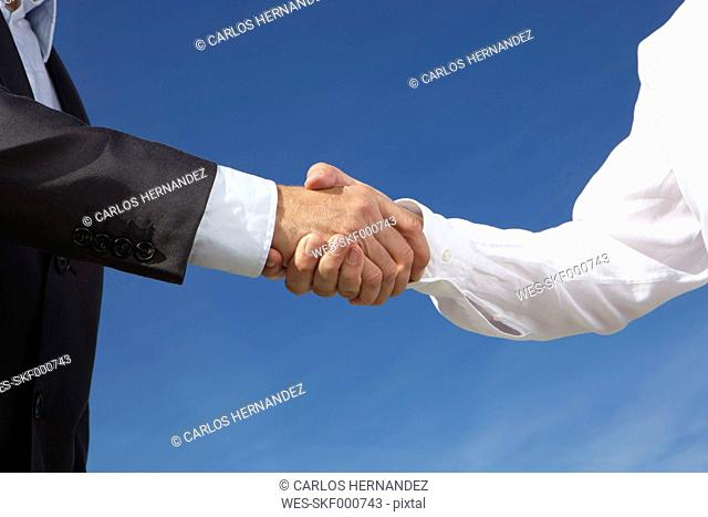 Germany, Bavaria, Munich, Business people shaking hands