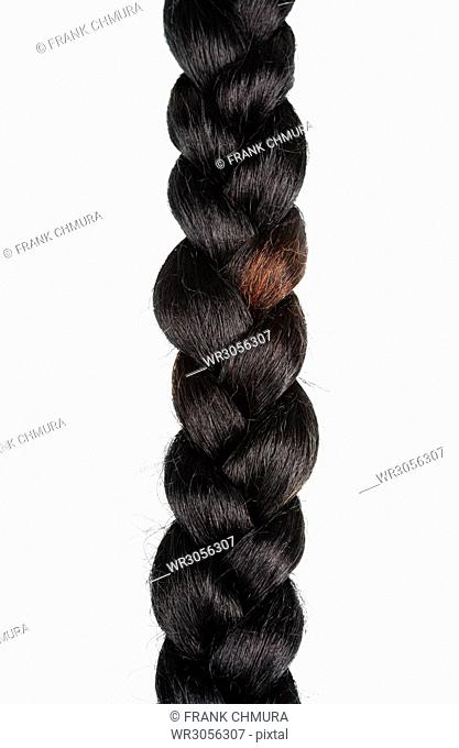 Braid of Artificial Hair Isolated on White Background