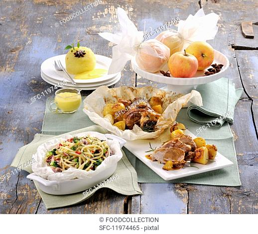 Various dishes on a rustic wooden table