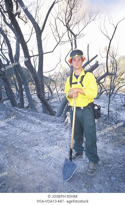 Forest fire fighter holding shovel, Los Angeles Padres National Forest, California