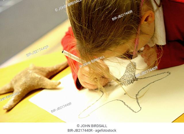 Girl decorating shell drawing using xxxx raised technique, Mysight Nottingham