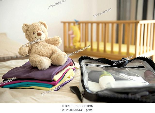 Baby bedroom cot teddy bear clothes suitcase