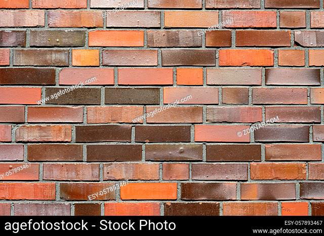 Hintergrund aus einer Backsteinwand mit verschiedenen Rotschattierungen