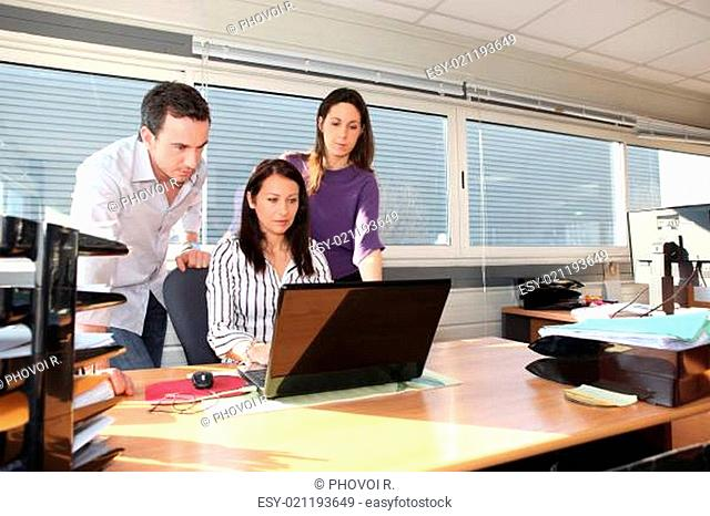Colleagues in front of laptop