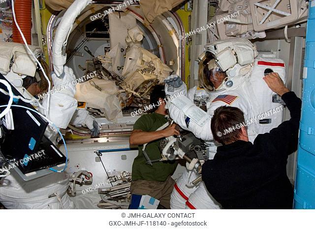 NASA astronaut Joe Acaba (center), Russian cosmonaut Yuri Malenchenko (right foreground), Japan Aerospace Exploration Agency astronaut Aki Hoshide (left) and...