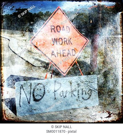 A sign indicating road work ahead and no parking