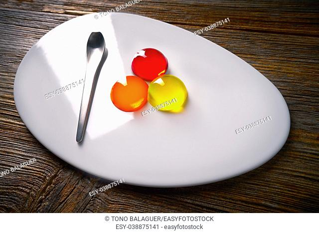 Molecular cuisine concept spheritions colorful in moodern oval plate jelly texture