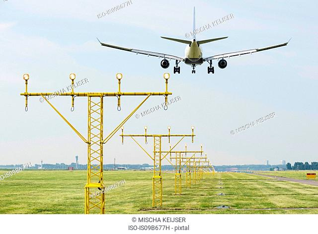 Airplane landing by runway landing lights, Schiphol, North Holland, Netherlands, Europe