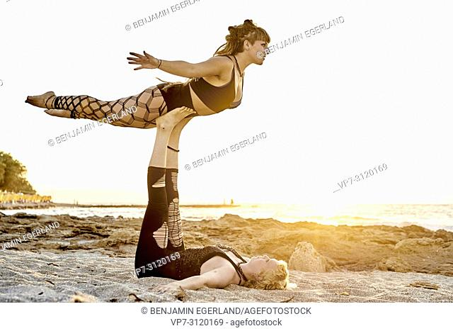 Yoga exercises in beach, Aerial Yoga, in holiday destination Chersonissos, Crete, Greece