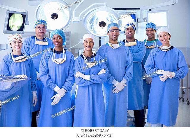 Portrait of confident team of surgeons in operating room