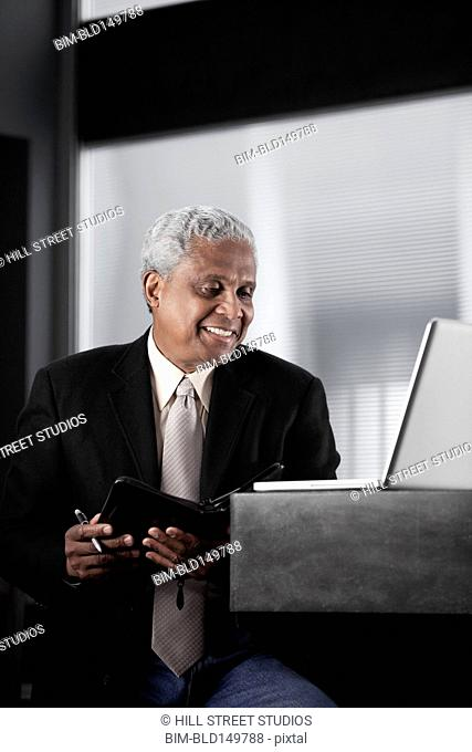 Black businessman using laptop