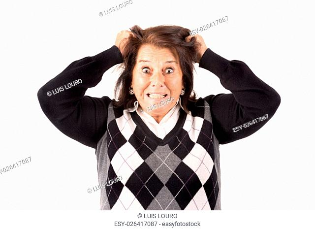 Desperate senior woman isolated in a white background
