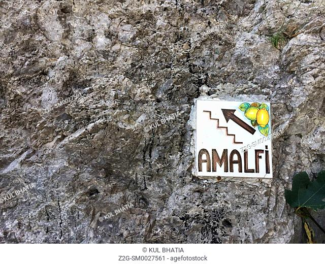 A slab in the wall points to steps going up to Amalfie, the home of sweet lemons and limoncello. Pictures and sculptures of lemons are everywhere as icons