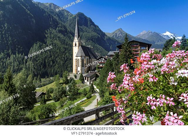 Europe, Austria, Carinthia, district of Spittal an der Drau. Heiligenblut with St Vincent Church and Grossglockner mountain on background