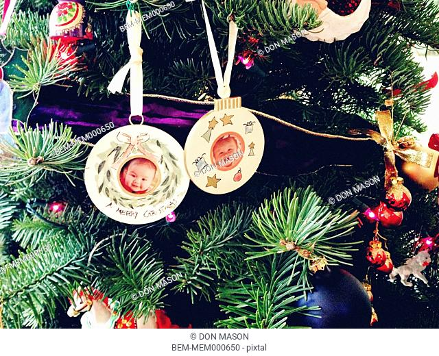 Photos of mixed race girls on Christmas ornaments