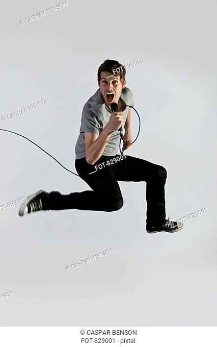 A singer jumping in mid-air