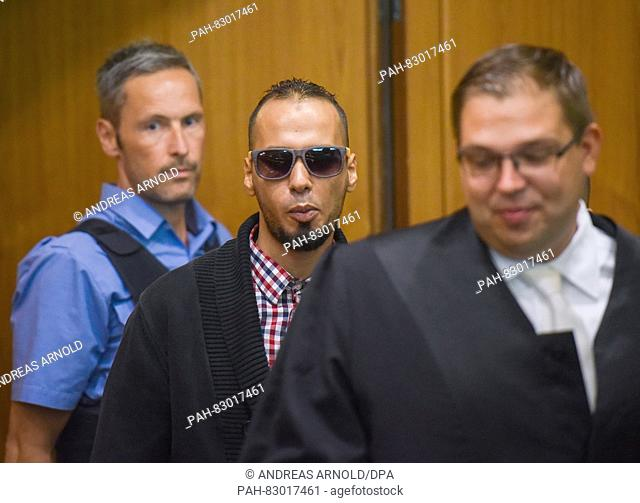 The accused Abdelkarim E. enters the courtroom of the higher regional court before the start of the trial in Frankfurt on the Main,germany, 22 August 2016