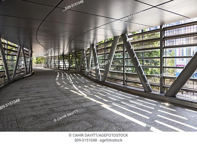 Architectural detail of elevated pedestrian walkway leading from the AIA Central Building to Chater Garden, Central District, Hong Kong, S. A. R