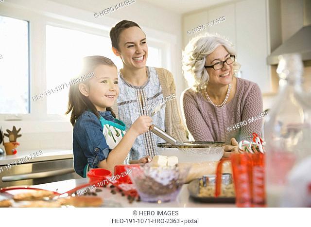 Three generation family baking cookies at Christmas