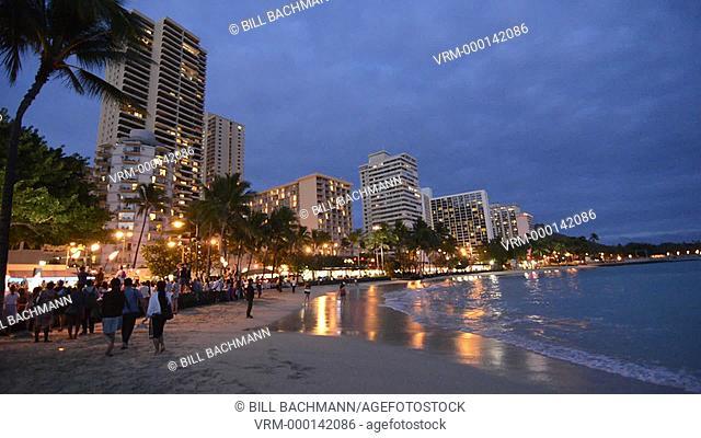 Honolulu Hawaii Oahu Waikiki Beach night time with hotels and beach at twilight