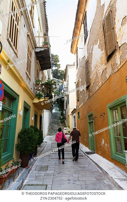 A couple walking at alley in Nafplion city. Argolis, Peloponnese, Greece