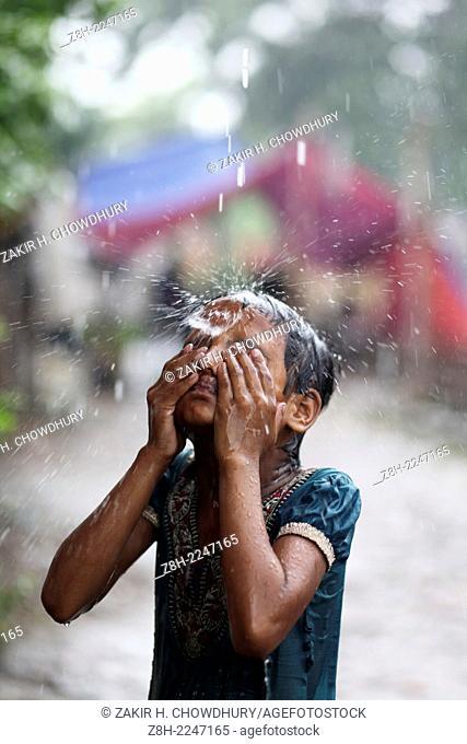 Slum children enjoying rain in Dhaka