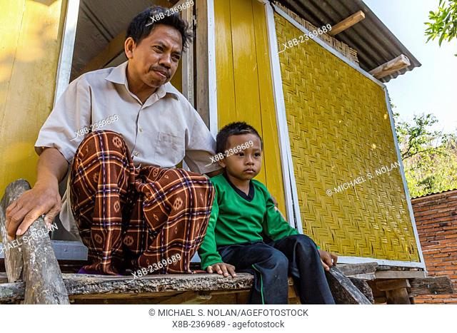Father and son in Pamulung Village near Badas, Sumbawa Island, Indonesia