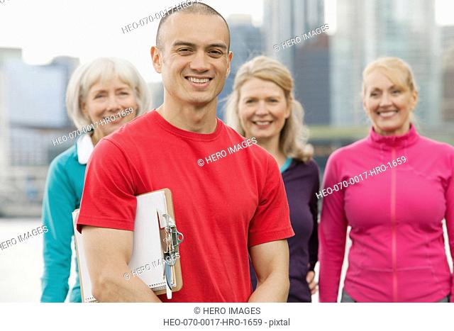 personal trainer with group of mature women