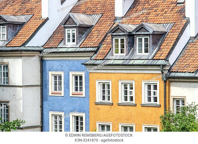 A bright blue and yellow house contrast each other in Warsaw, Poland