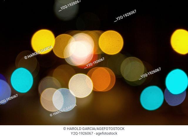 Abstract circular bokeh of car lights at night in New York City, New York  USA