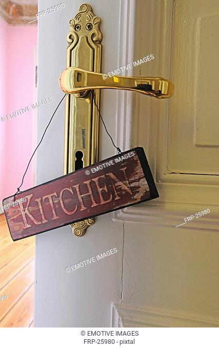 Kitchen sign at door knob