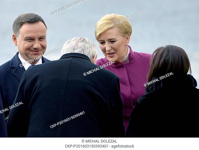 Czech President Milos Zeman (backs left) and his wife Ivana Zemanova (backs right) welcome Polish President Andrzej Duda (left) and his wife Agata...