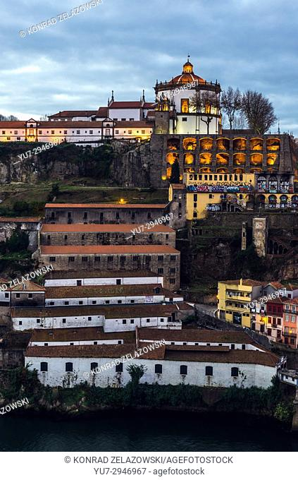 Monastery of Serra do Pillar above Port wine cellars on the bank of Douro River in Vila Nova de Gaia city, Portugal. View from Porto city