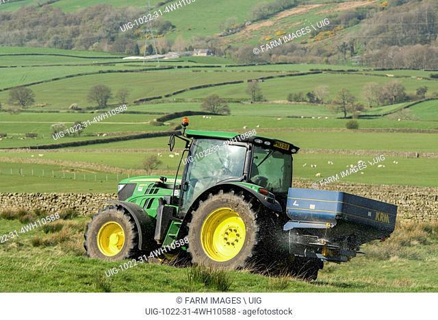 John Deere 6126r spreading fertiliser on upland pasture, Lancashire, UK. (Photo by: Wayne Hutchinson/Farm Images/UIG)