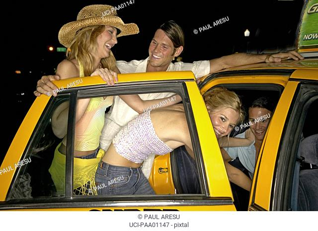 Couples getting into taxi