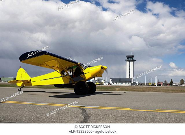 Piper Super Cub on the runway at Merrill Field, South-central Alaska; Anchorage, Alaska, United States of America