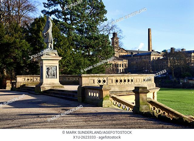 Titus Salt Statue in Roberts Park with Salts Mill Beyond Saltaire West Yorkshire England