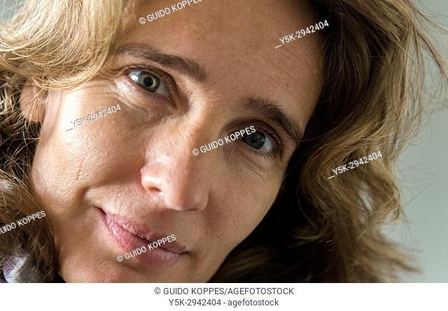 Tilburg, Netherlands. Close-up portrait of an adult, blonde woman