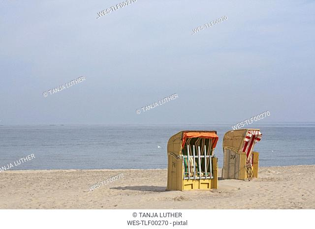 Germany, Baltic Sea, Beach chairs on shore