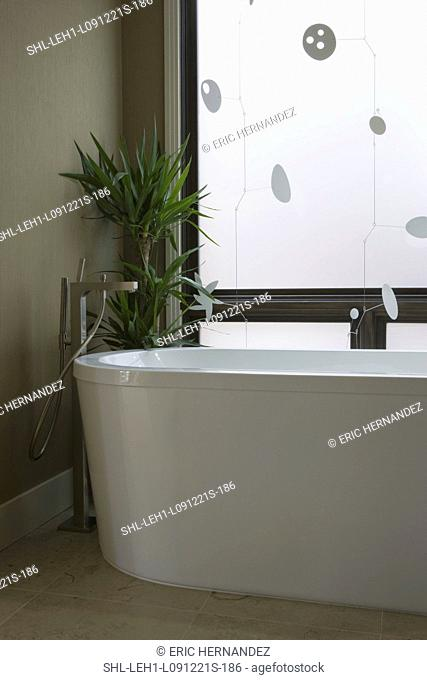 Detail modern bathtub and faucet