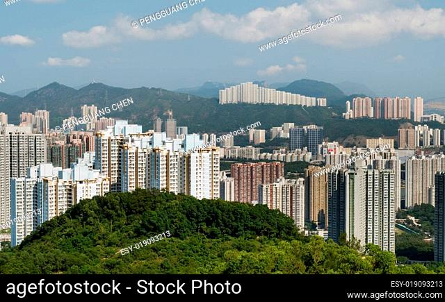 Tall apartments with green mountain