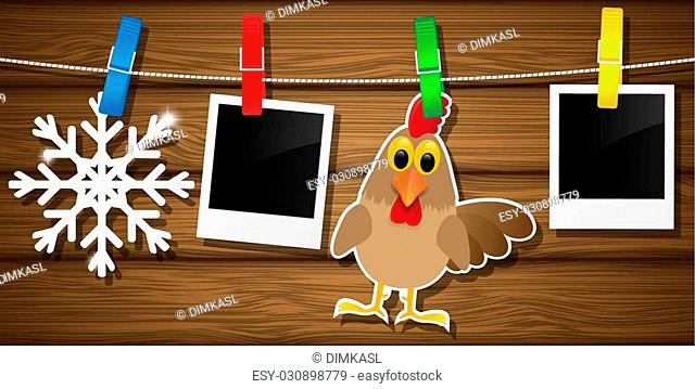 Blank photo frames, rooster and snowflake on a clothesline