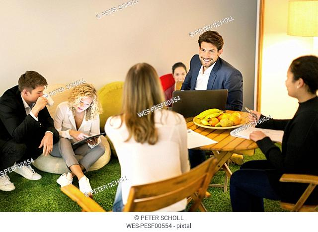 Business people working having a casual meeting in the office