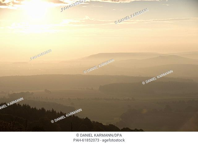 The sun breaks through the wafts of mist at sunrise on Hesselberg mountain, Germany, 22 September 2015. The mountain with its height of 689 m above sea level is...