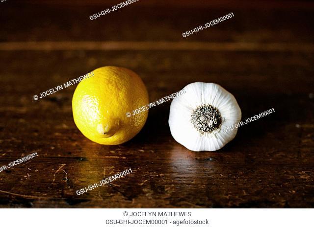 Lemon and Garlic on Wood Table