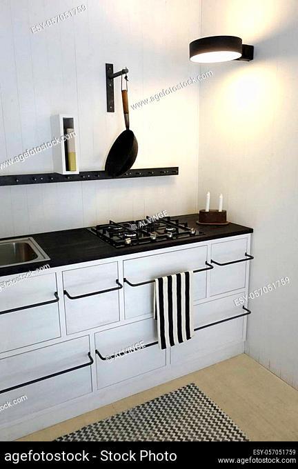Retro Kitchen in bright white colors. Minimalistic, sparse and contemporary interior design