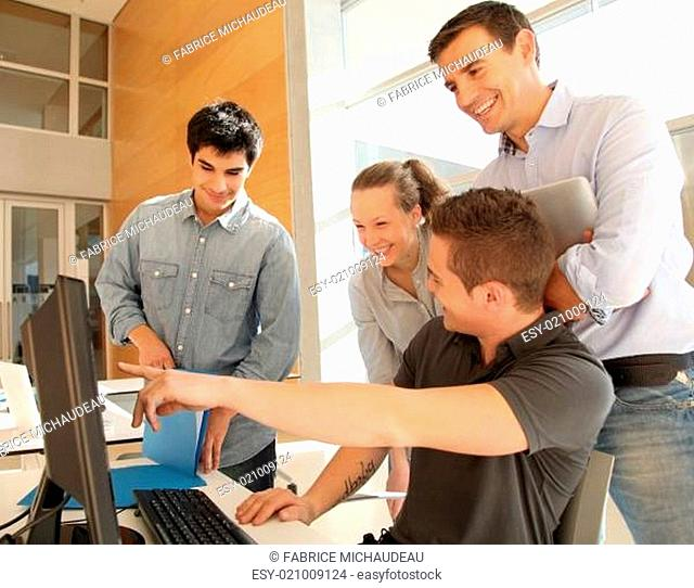 Teacher with group of students in class